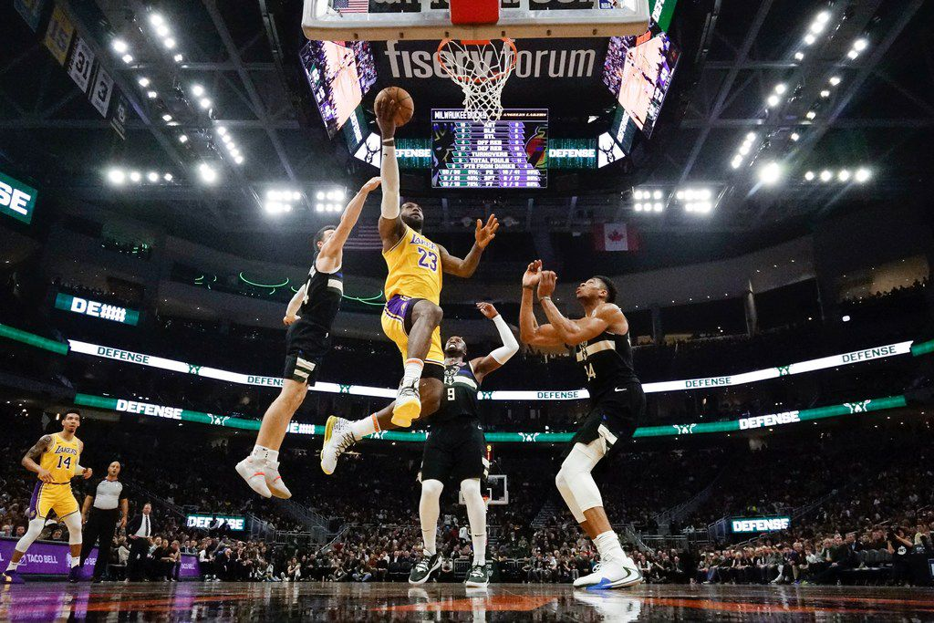Los Angeles Lakers' LeBron James shoots during the first half of an NBA basketball game against the Milwaukee Bucks Thursday, Dec. 19, 2019, in Milwaukee. (AP Photo/Morry Gash)