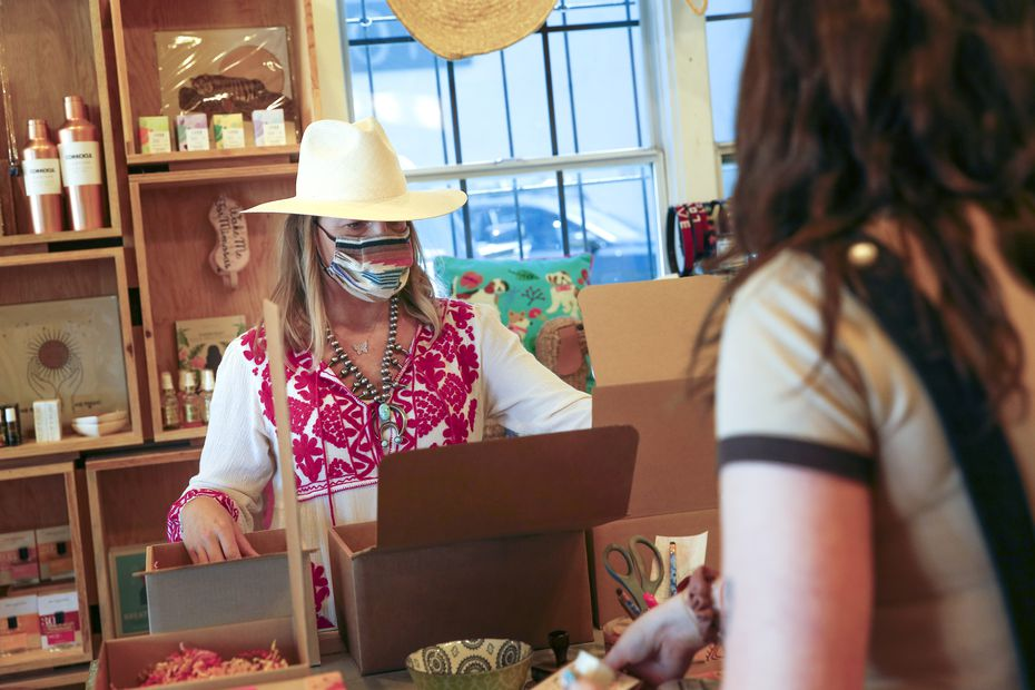 Owner Carley Seale (left) helped pack pick-up orders with Mary Walton at Favor The Kind on Henderson in Dallas when stores were forced to close in the spring.