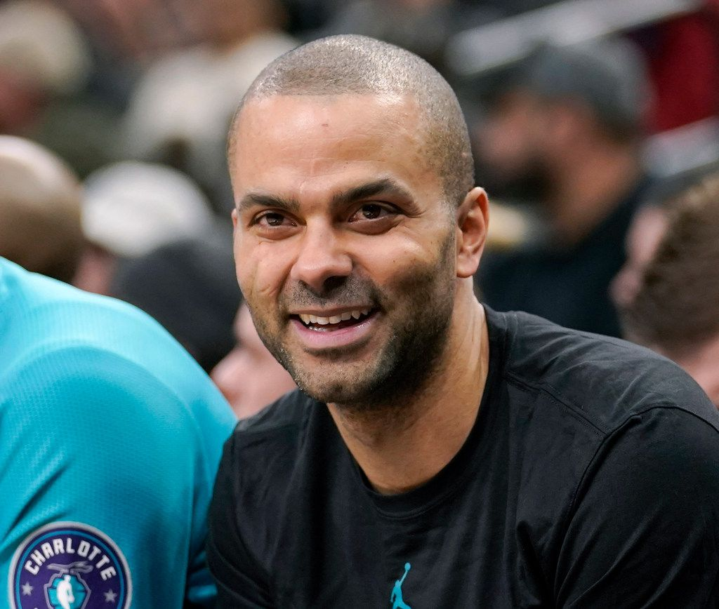 """FILE - In trhis Jan. 14, 2019, file photo, Charlotte Hornets' Tony Parker laughs on the bench during the second half of an NBA basketball game against the San Antonio Spurs, in San Antonio.  Four-time NBA champion Tony Parker has announced he's retiring after 18 seasons. The 37-year-old guard played 17 said on Twitter Monday, June 10, 2019, that it was an emotional decision and that it has been an """"incredible journey."""" He played 17 seasons for the San Antonio Spurs and made the postseason every year of his career before joining the Hornets last season and missing the playoffs. He was selected to the All-Star team six times and was named second-team All-NBA three times. (AP Photo/Darren Abate)"""