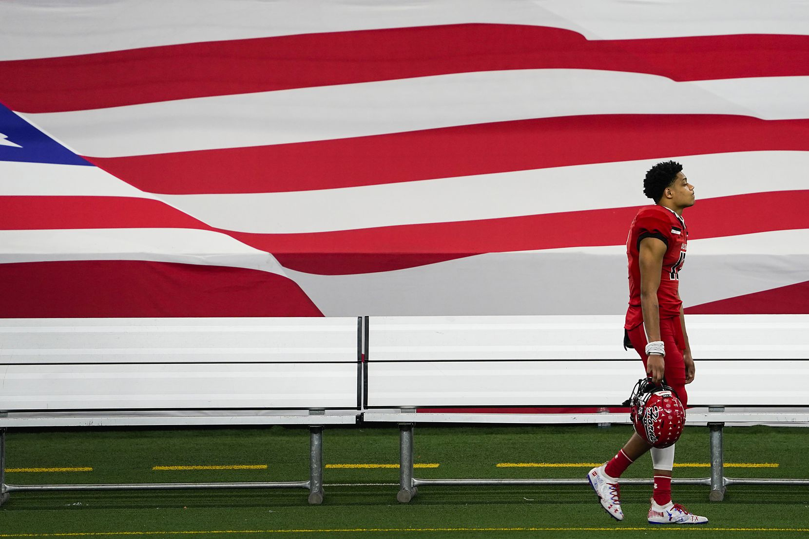 Cedar Hill wide receivers Javien Clemmer leaves the field after a loss to Katy in the Class 6A Division II state football championship game at AT&T Stadium on Saturday, Jan. 16, 2021, in Arlington, Texas. Katy won the game 51-14.