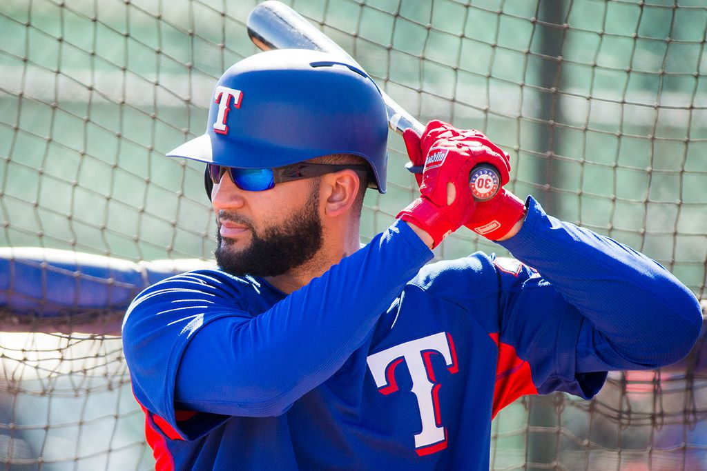 Texas Rangers right fielder Nomar Mazara hits in the batting cage during a spring training workout at the team's training facility on Wednesday, Feb. 21, 2018, in Surprise, Ariz. (Smiley N. Pool/The Dallas Morning News)