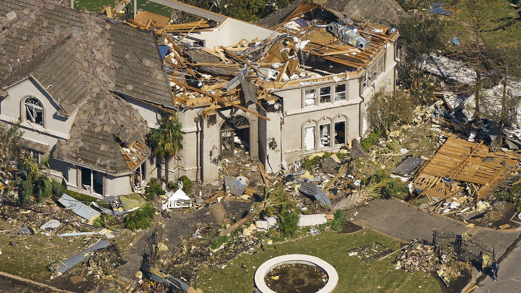 Damage is seen to a home owned by Dallas Stars NHL hockey player Tyler Seguin near the intersection of Preston and Royal in aerial view of tornado damage on Monday, Oct. 21, 2019, in Dallas. Seguin moved from the house last November, and said no one was injured. The house is currently for sale.