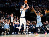 FILE - Mavericks forward Kristaps Porzingis (6) shoots a 3-pointer over Grizzlies point guard Ja Morant (12) during the first half of a game at American Airlines Center on Wednesday, Feb. 5, 2020, in Dallas.