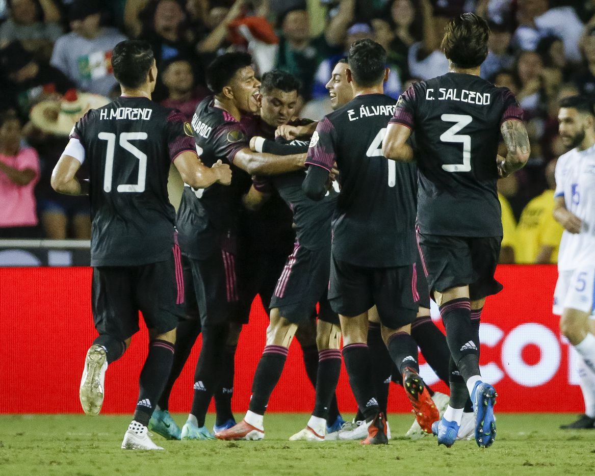 Mexico players celebrate after Mexico defender Luis Rodríguez (21) scored a goal during the first half of a CONCACAF Gold Cup Group A soccer match at the Cotton Bowl on Sunday, July 18, 2021, in Dallas. (Elias Valverde II/The Dallas Morning News)