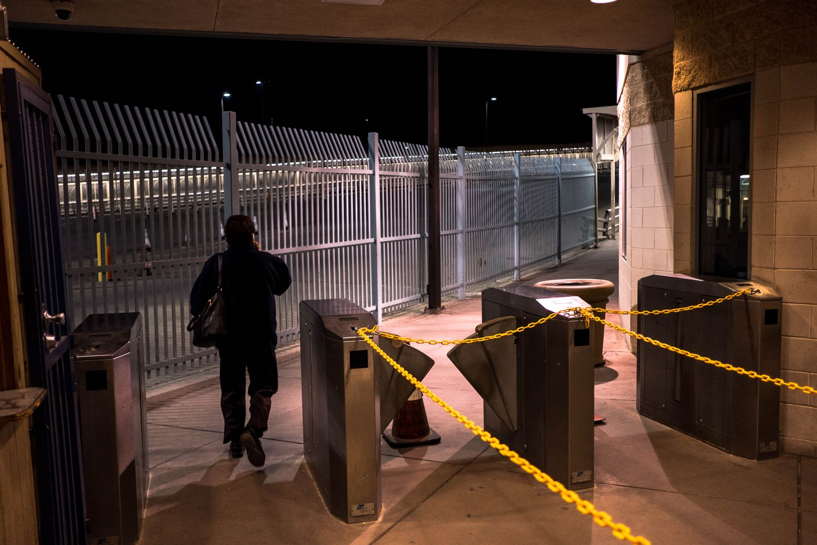 A traveler walked past the entrance to the Paso Del Norte Port of Entry in El Paso on the way to Ciudad Juárez, Mexico, Saturday, March 21, 2020.