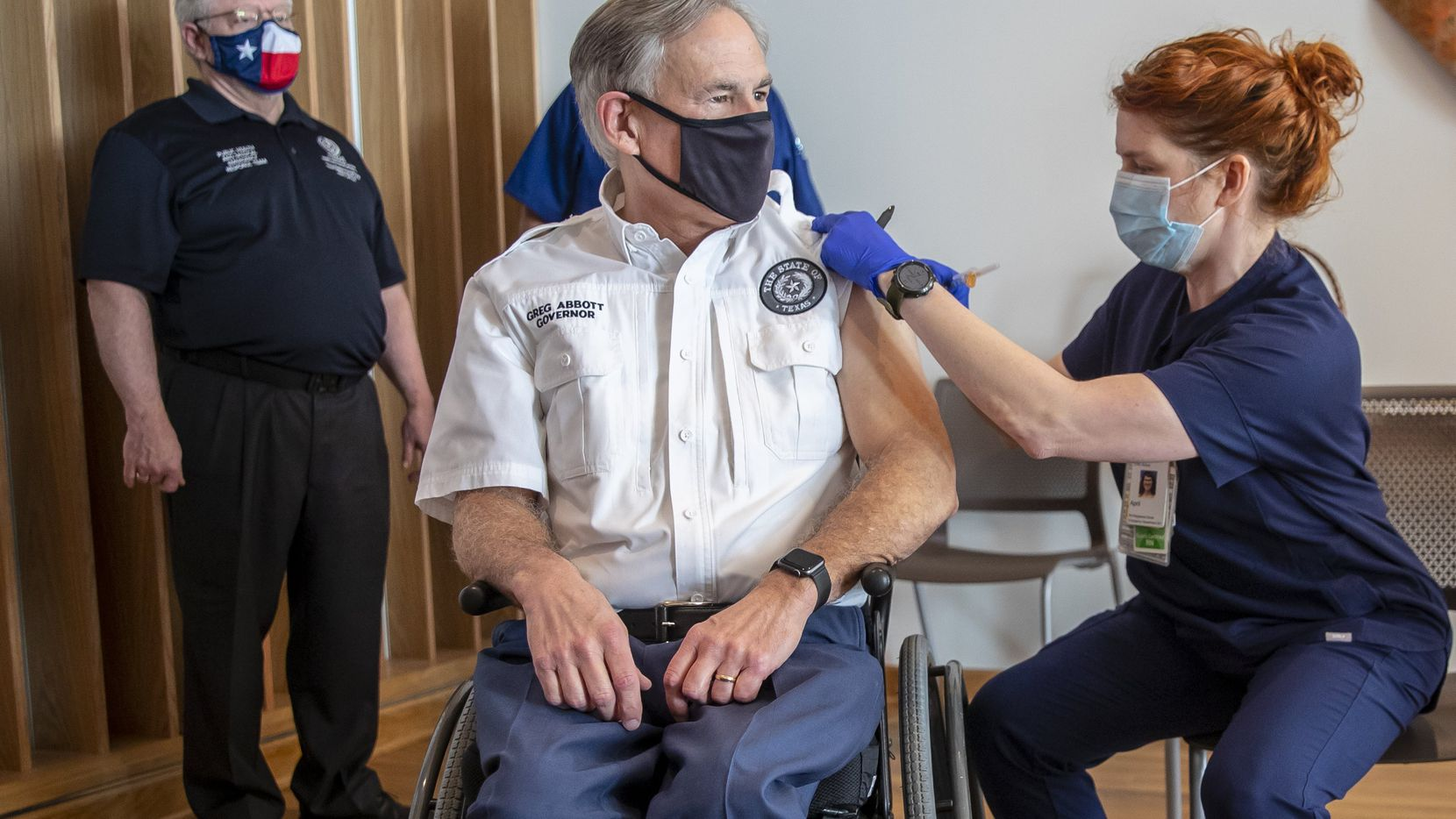 Registered nurse April Burge gave Texas Gov. Greg Abbott a COVID-19 vaccine shot on Dec. 22, 2020. The governor announced Aug. 17 that he had tested positive for COVID-19.