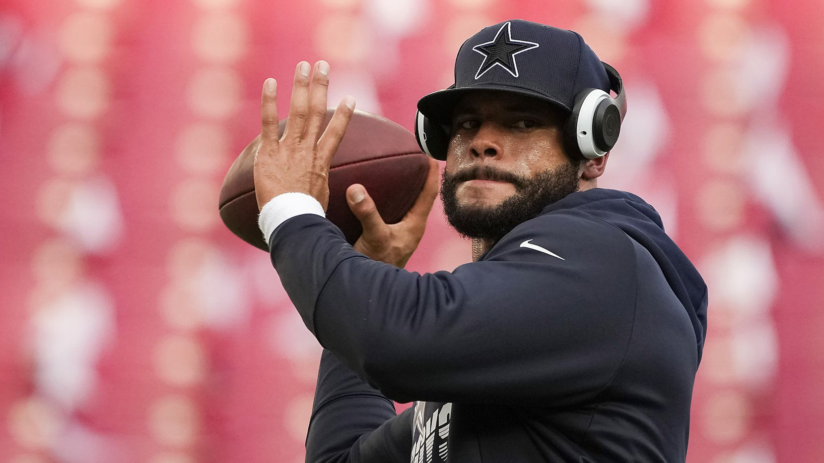 Dallas Cowboys quarterback Dak Prescott warms up before an NFL football game against the Tampa Bay Buccaneers at Raymond James Stadium on Thursday, Sept. 9, 2021, in Tampa, Fla.