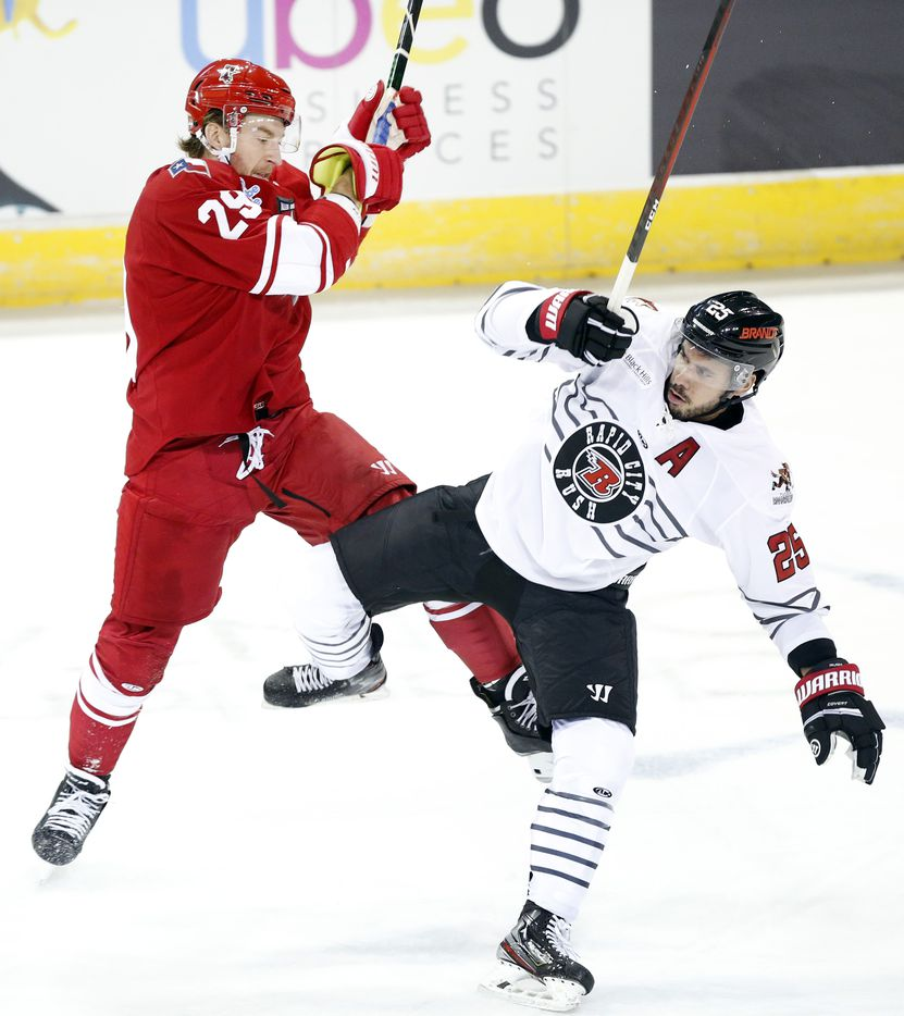 Allen Americans forward Jesse Mychan (29) collides with Rapid City Rush defenseman Mikael Tam (25) during the first period at the Allen Event Center in Allen, Texas, Friday, December 18, 2020. This is the first professional hockey game in the metroplex since March. (Tom Fox/The Dallas Morning News)