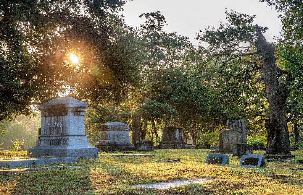 The sun rises over the Oakland Cemetery in South Dallas on Thursday, Aug. 29, 2019. The historic cemetery, which contains the graves of notable figures from the city's early beginnings, has ceased operations. (Lynda M. Gonzalez/The Dallas Morning News)