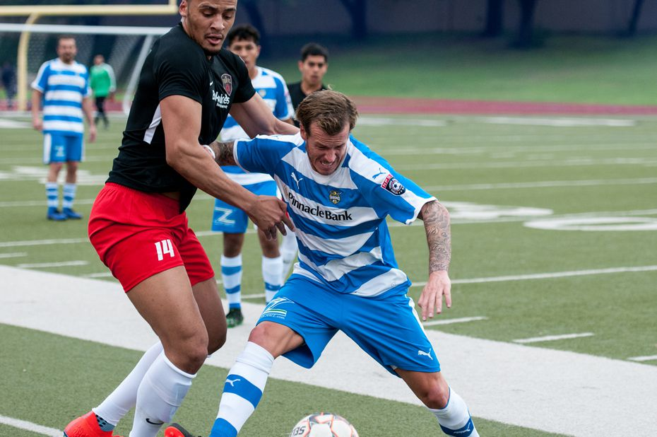 Vaqueros standout Jamie Lovegrove holds off a Tyler FC defender in the Vaqueros 3-0 win to open the 2019 season.