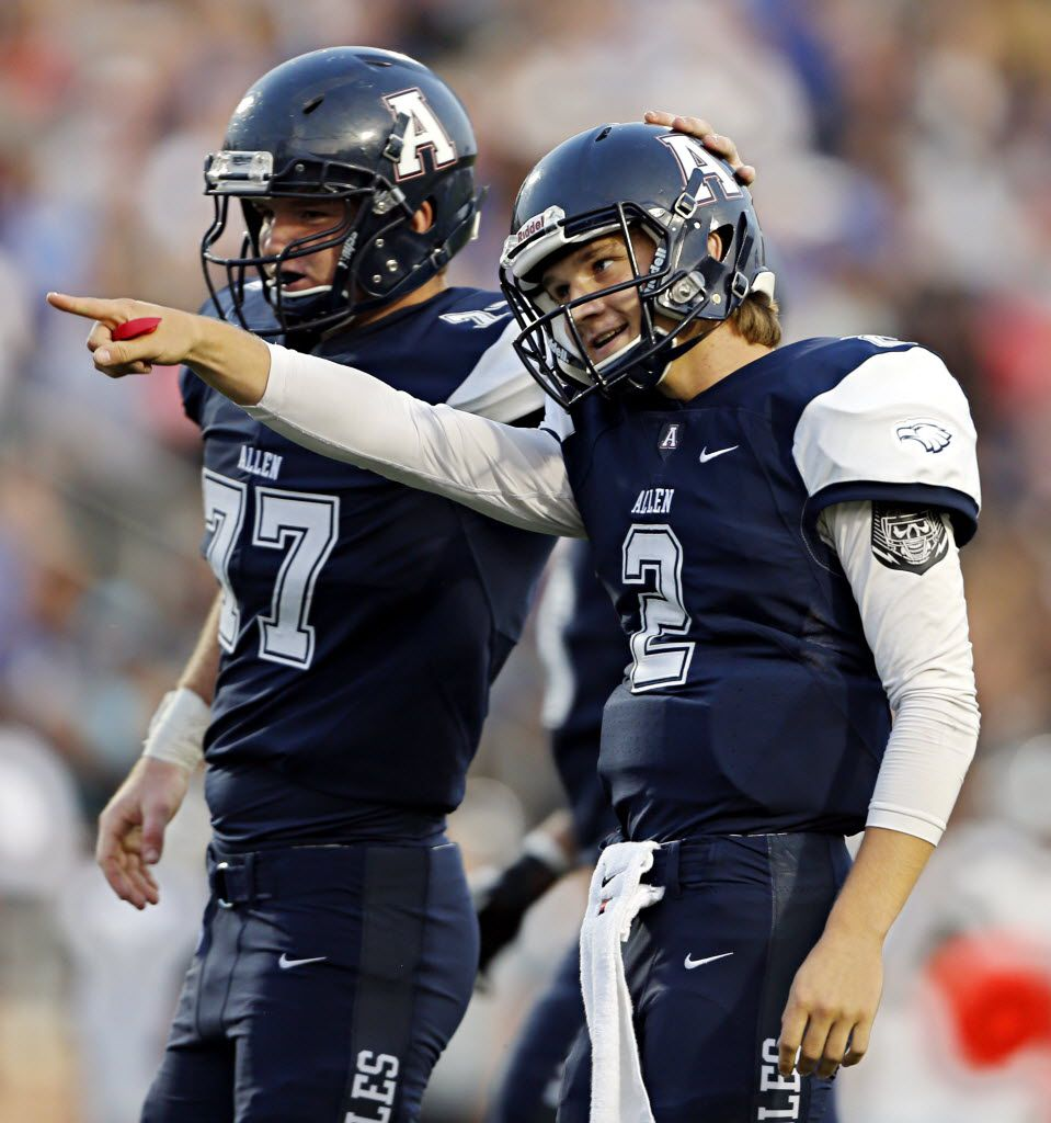 Allen's Peter Nicklas (77) congratulates Mitchell Jonke on his touchdown during the first half against Denton Guyer at Eagle Stadium Friday, August 28, 2015 in Allen, Texas. (G.J. McCarthy/The Dallas Morning News)