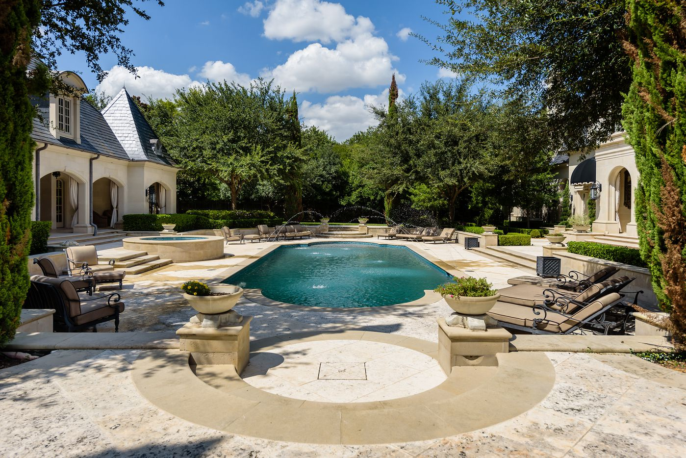 The estate has two movie theaters, swimming pools and tennis courts.