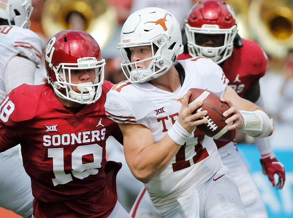 Texas Longhorns quarterback Sam Ehlinger (11) rolls out away from pressure from Oklahoma Sooners linebacker Curtis Bolton (18) during the University of Texas Longhorns vs. the Oklahoma Sooners NCAA football game at the Cotton Bowl in Dallas on Saturday, October 6, 2018. (Louis DeLuca/The Dallas Morning News)