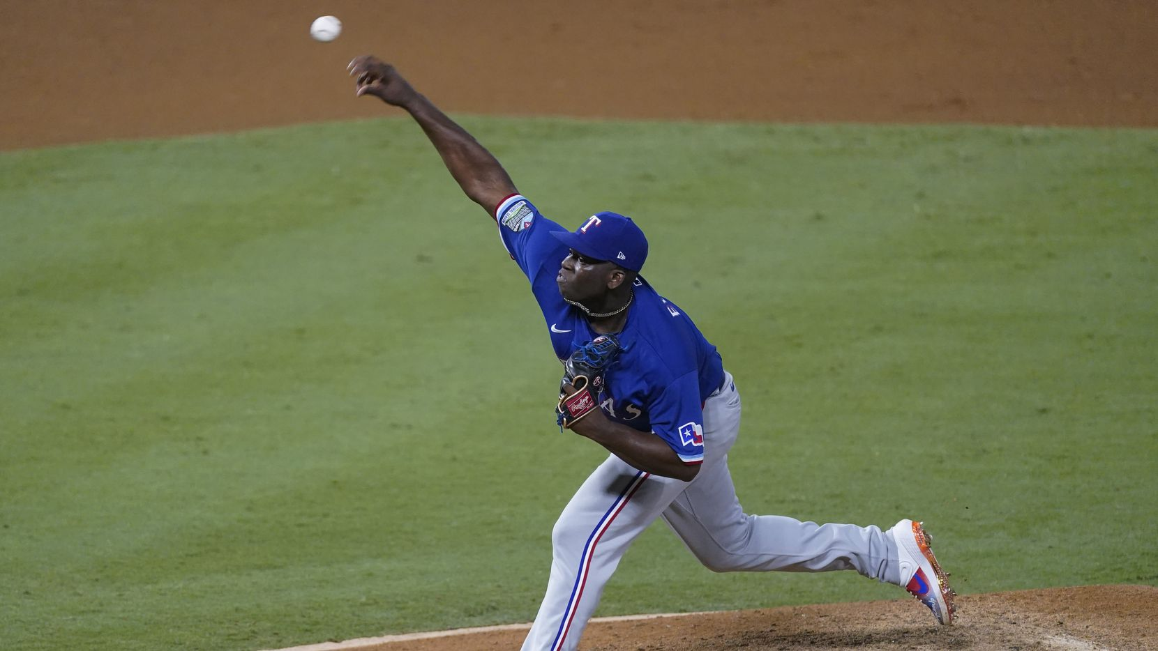 Texas Rangers relief pitcher Demarcus Evans throws during the seventh inning of the team's baseball game against the Los Angeles Angels on Friday, Sept. 18, 2020, in Anaheim, Calif. (AP Photo/Ashley Landis)