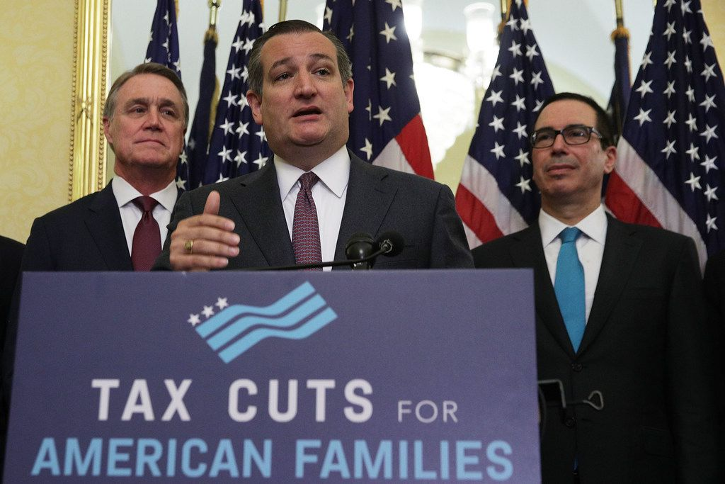 """U.S. Sen. Ted Cruz (R-TX) (2nd L) speaks as Sen. David Perdue (R-GA, left) and Secretary of the Treasury Steven Mnuchin listen during a news conference on tax reform. Senate Republicans held a news conference to discuss """"the need for tax reform and the impact it will have on American families, small businesses and the economy."""""""