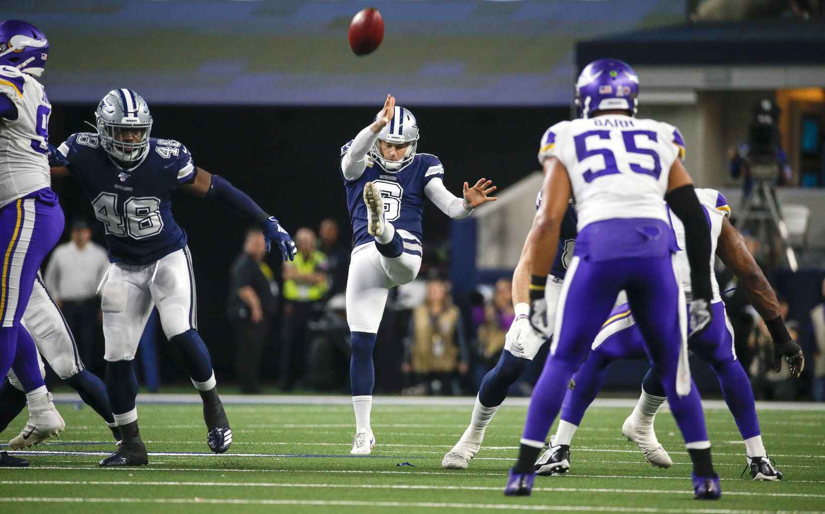 FILE - The Cowboys' Chris Jones (6) punts the ball during the first quarter of a game against the Minnesota Vikings at AT&T Stadium in Arlington on Sunday, Nov. 10, 2019.