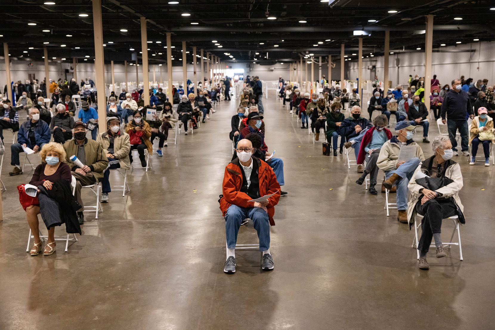 People wait to receive the COVID-19 vaccine at Fair Park in Dallas on Thursday, Jan. 14, 2021. A limited number of COVID-19 vaccine shots will be available Thursday at Fair Park for North Texans 75 and older.