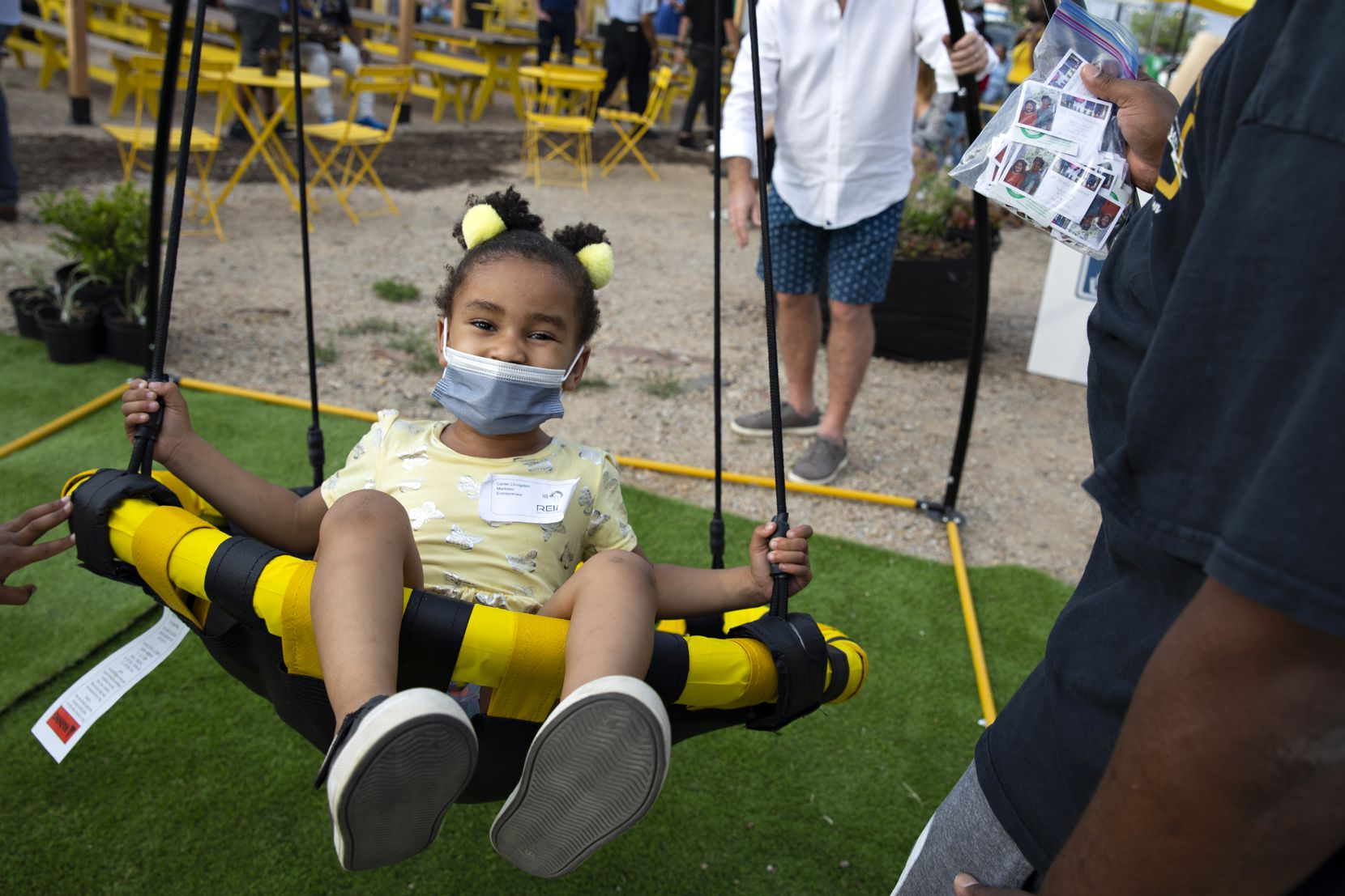 Carter Livingston, 4, soared in a swing at the launch of the MLK Food Park in Dallas on April 9, 2021.