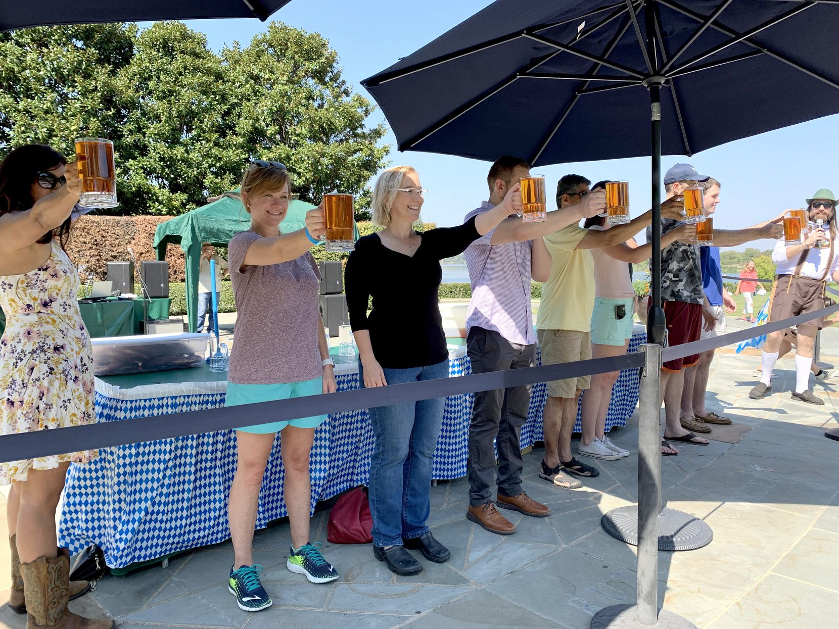 People participate in a stein-holding competition at the Dallas Arboretum's Oktoberfest event Oct. 5, 2019. This year's Oktoberfest event will be held Sept. 20, 2020, from 11 a.m. to 4 p.m.
