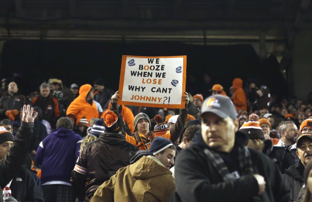A fan holds a sign referring to Cleveland Browns quarterback Johnny Manziel during an NFL football game between the Cleveland Browns and the Baltimore Ravens Monday, Nov. 30, 2015, in Cleveland. Baltimore won 33-27. (AP Photo/David Richard)
