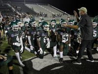 Kennedale coach Richard Barrett speaks with his players following the Wildcats' 28-27 victory over Sunnyvale on September 11, 2020. (Steve Hamm/Special Contributor)