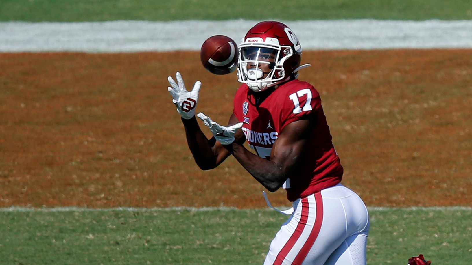 Oklahoma Sooners wide receiver Marvin Mims (17) pulls in a first quarter touchdown pass against the Texas Longhorns in the Red River Rivalry at the Cotton Bowl in Dallas, Saturday, October 10, 2020. Oklahoma won in quadruple overtime, 53-45.