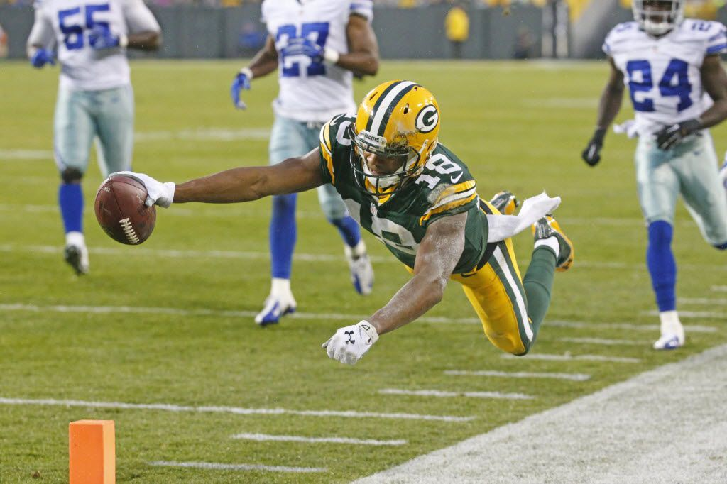 Green Bay Packers wide receiver Randall Cobb (18) dives for the end zone but was ruled out of bounds inside the ten yard line on a first-quarter play during the Dallas Cowboys vs. the Green Bay Packers NFL football game at Lambeau Field in Green Bay, Wisconsin on Sunday, December 13, 2015. (Louis DeLuca/The Dallas Morning News)