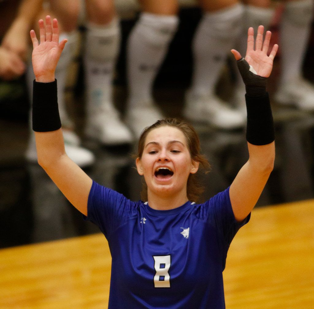 Trophy Club Byron Nelson outside hitter Paige Flickinger (8) was all smiles following a Lady Bobcats score during the opening game of their match against Denton Guyer. The two teams played their Class 6A Region l championship volleyball match at W.G. Thomas Coliseum in Haltom City on November 16, 2019. (Steve Hamm/ Special Contributor)
