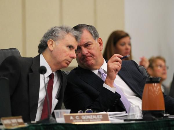Interim City Manager A.C. Gonzalez and Mayor Mike Rawlings talked at an August council meeting. Rawlings' office is now scrutinizing Gonzalez's actions on Uber.