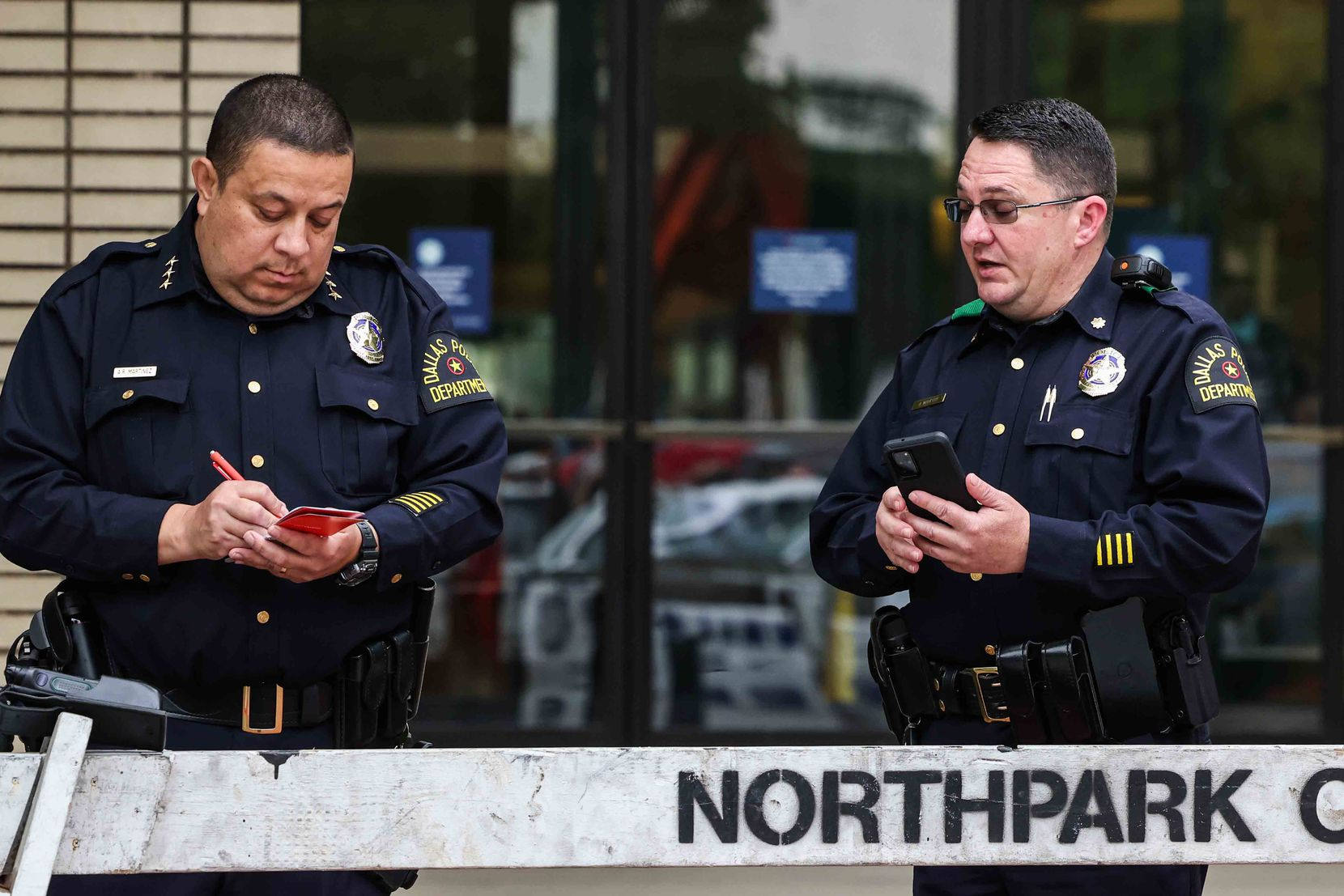 Dallas police officers stand outside the NorthPark Center on Monday.