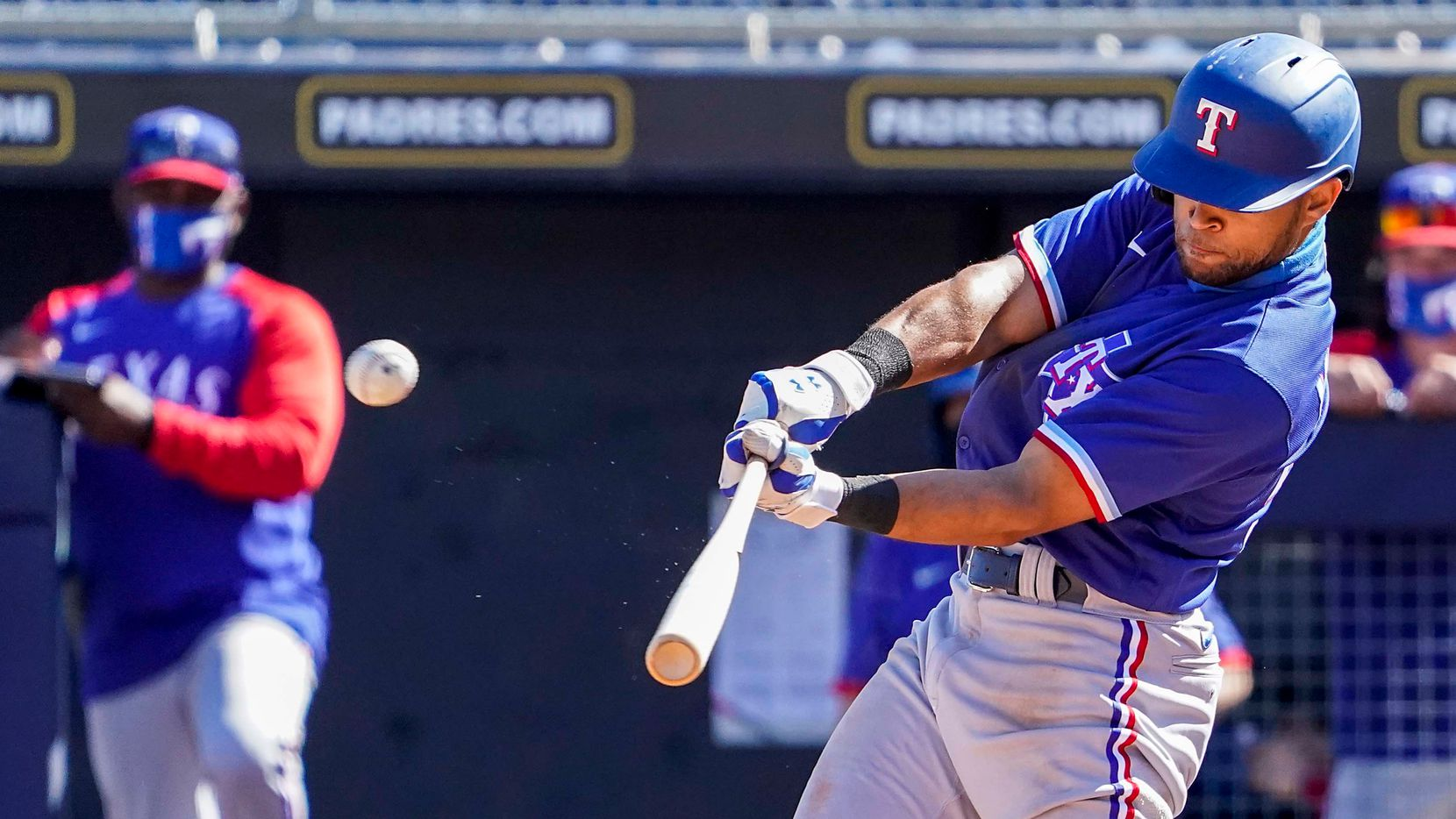Texas Rangers outfielder Jason Martin hits a solo home run during the fifth inning of a spring training game against the Seattle Mariners at Peoria Sports Complex on Wednesday, March 10, 2021, in Peoria, Ariz.