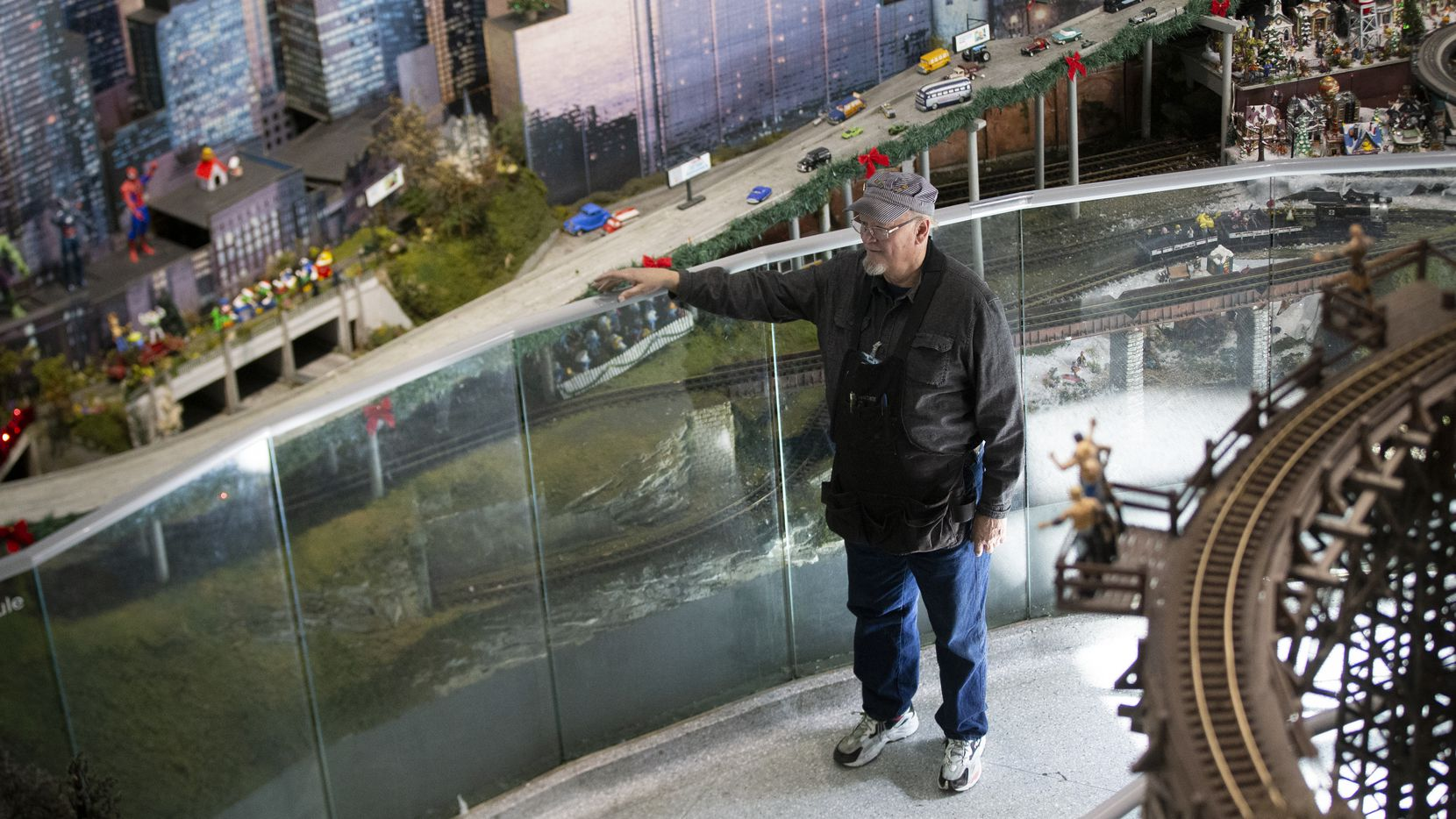 """Felder Fitzgerald, the """"train engineer"""" at Children's Medical Center, looks over the display in Dallas. Fitzgerald has kept the trains running for over 30 years."""