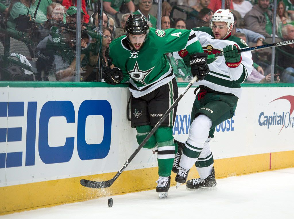 Apr 16, 2016; Dallas, TX, USA; Dallas Stars defenseman Jason Demers (4) and Minnesota Wild right wing Nino Niederreiter (22) chase the puck during the first period of game two of the first round of the 2016 Stanley Cup Playoffs at the American Airlines Center. Mandatory Credit: Jerome Miron-USA TODAY Sports