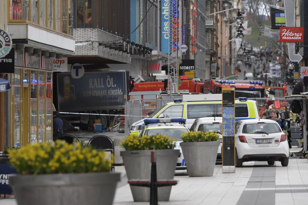 The rear of a truck, left, protrudes after it crashed into a department store injuring several people in central Stockholm, Sweden, Friday April 7, 2017.