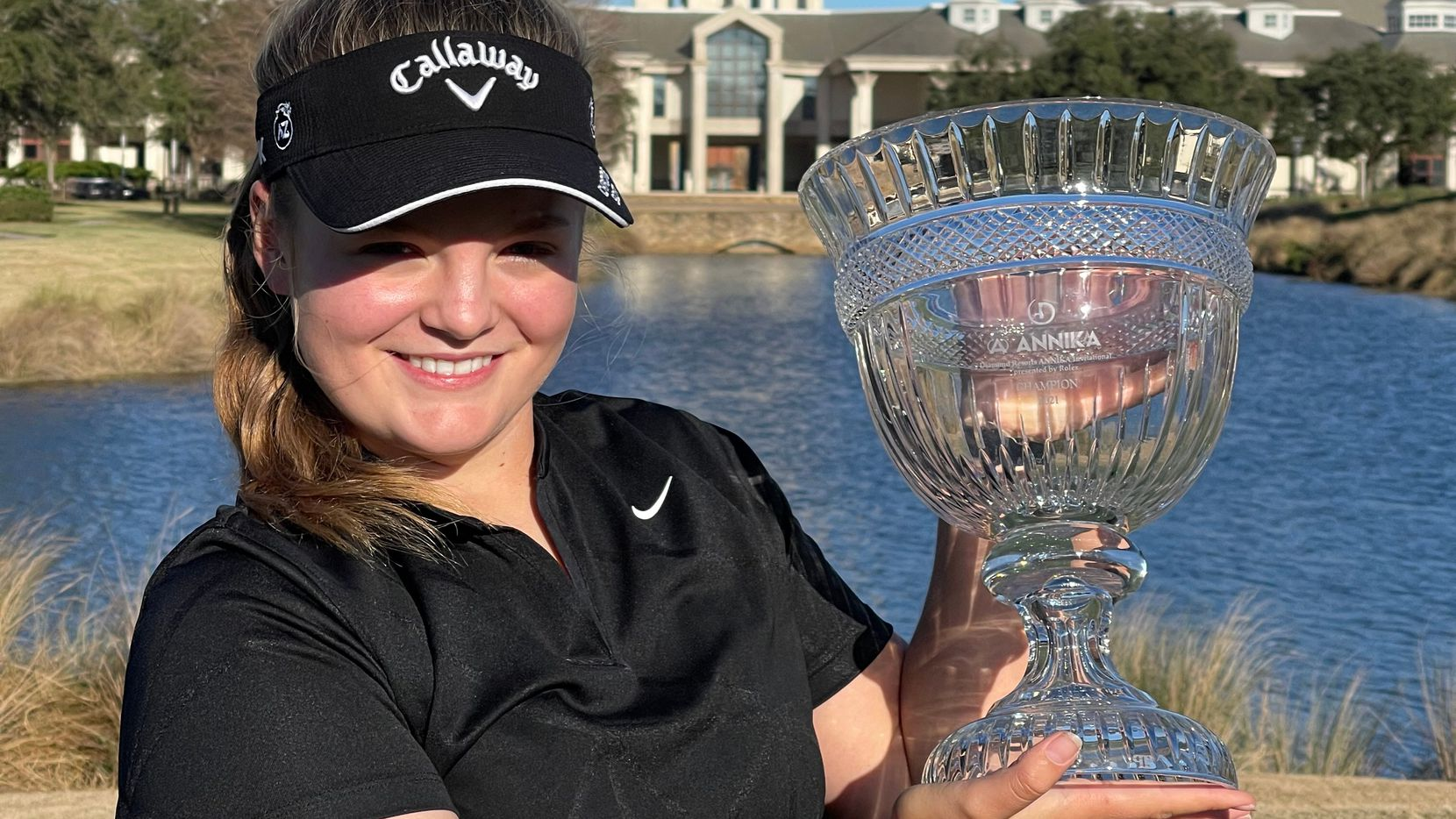 Avery Zweig holds up her trophy from the American Junior Golf Association's Annika Invitational.