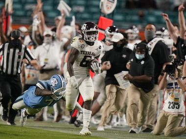 Texas A&M running back Devon Achane (6) runs for a touchdown during the second half of the Orange Bowl NCAA college football game, Saturday, Jan. 2, 2021, in Miami Gardens, Fla. Texas A&M defeated North Carolina 41-27.