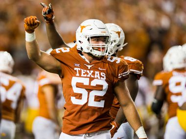 Texas Longhorns offensive lineman Samuel Cosmi (52) celebrates a field goal at the end of the second quarter of an NCAA football game between the Texas Longhorns and the USC Trojans on Saturday, September 15, 2018 at Darrell K Royal Memorial Stadium in Austin, Texas.
