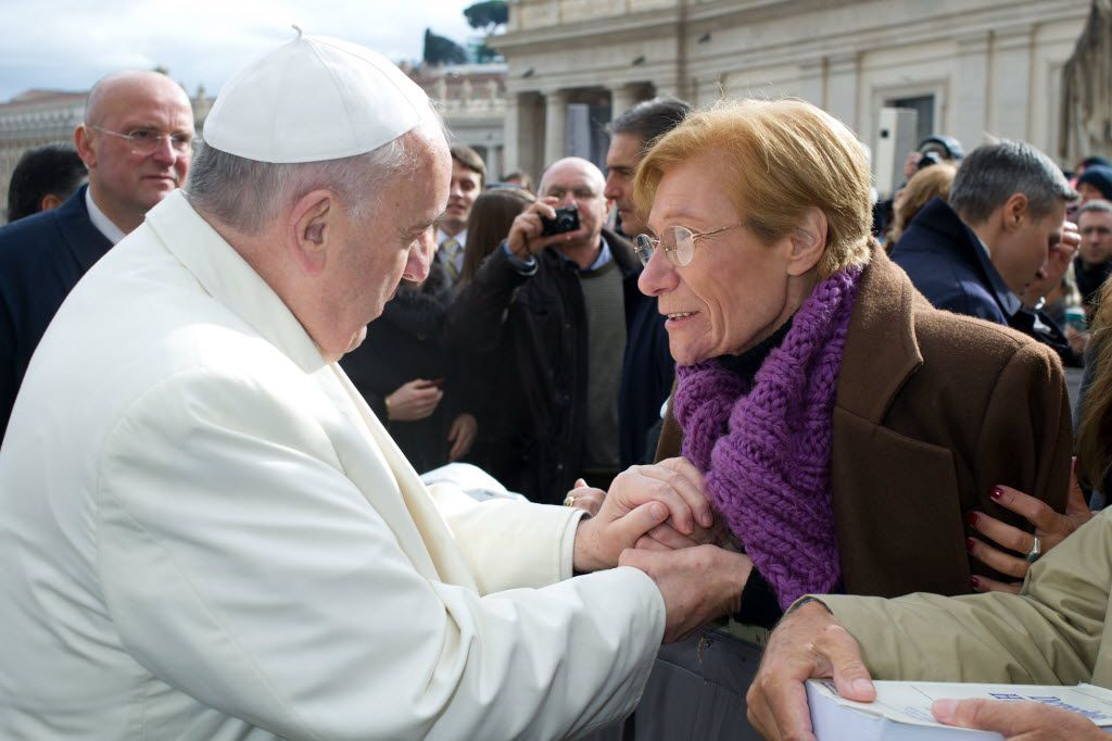 Pope Francis meets Argentine Lidia Guerrero in St. Peter's Square at the Vatican.