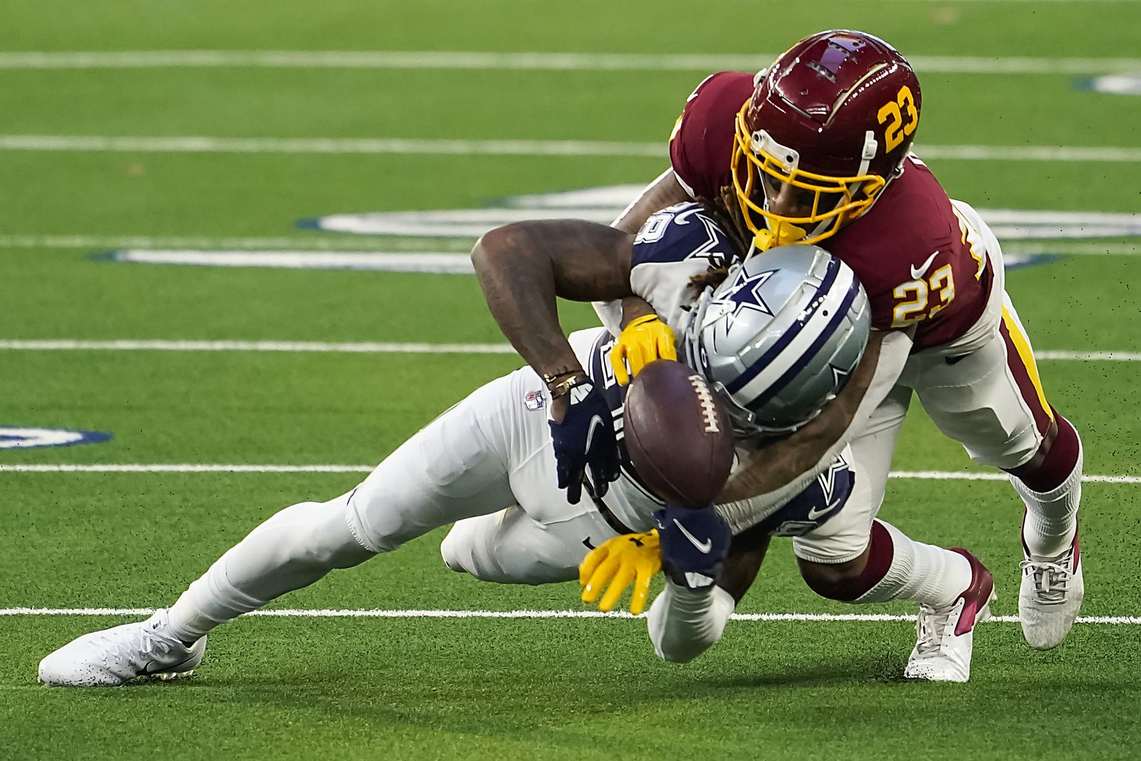 Washington Football Team cornerback Ronald Darby (23) breaks up a pass to Dallas Cowboys wide receiver CeeDee Lamb (88) on a fourth-and-one play during the second quarter of an NFL football game at AT&T Stadium on Thursday, Nov. 26, 2020, in Arlington. (Smiley N. Pool/The Dallas Morning News)