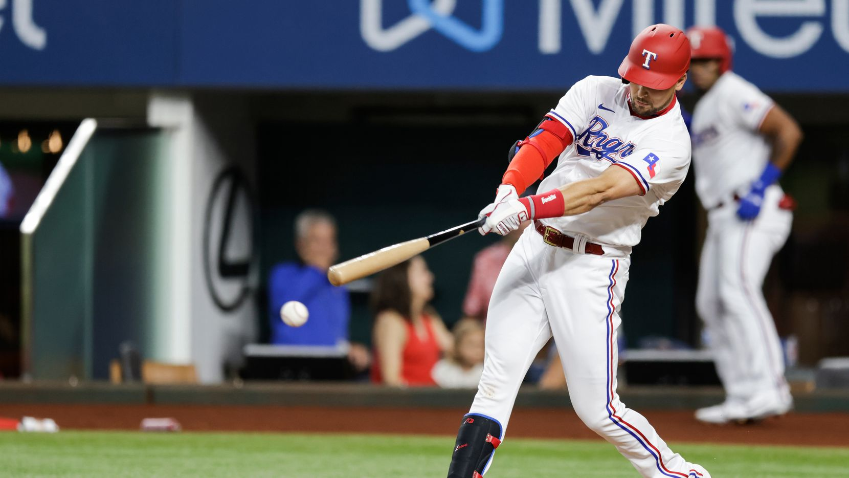 Texas Rangers'  Nate Lowe connects for an RBI double during the first inning of a baseball game against the Oakland Athletics in Arlington, Monday, June 21, 2021. (Brandon Wade/Special Contributor)