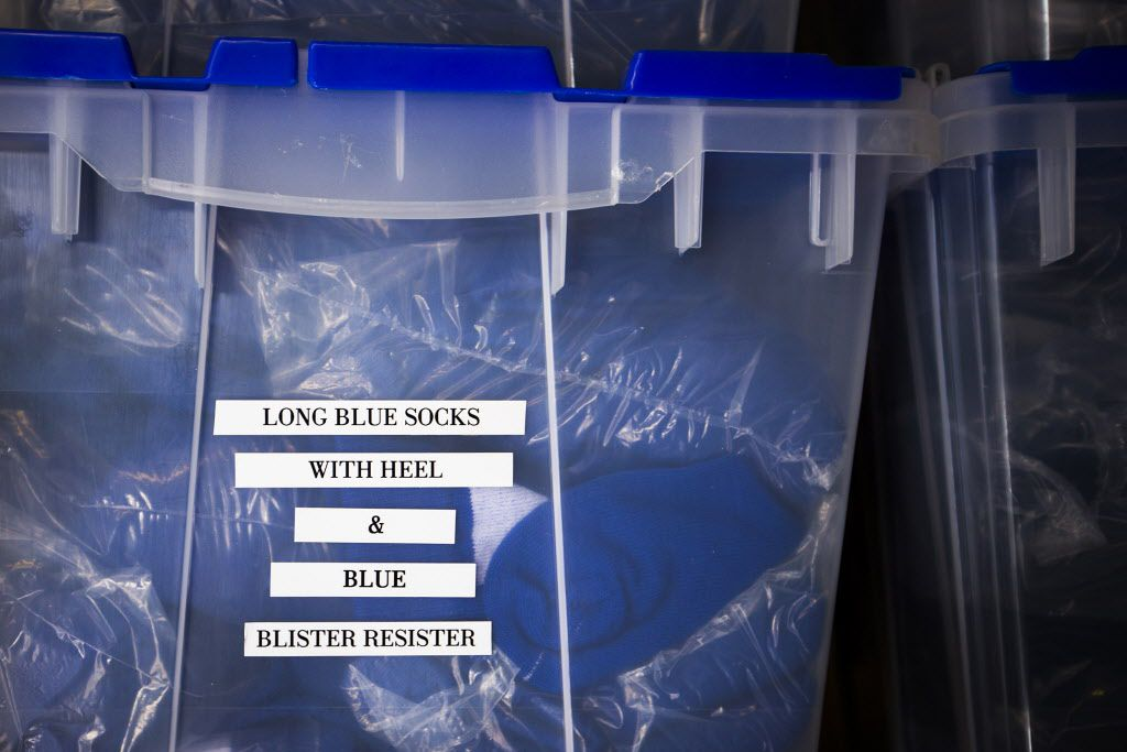 Tubs of socks fill shelves in the equipment room of Texas Rangers newly renovated spring training facility during a media tour on Thursday, Feb. 18, 2016, in Surprise, Ariz. (Smiley N. Pool/The Dallas Morning News)