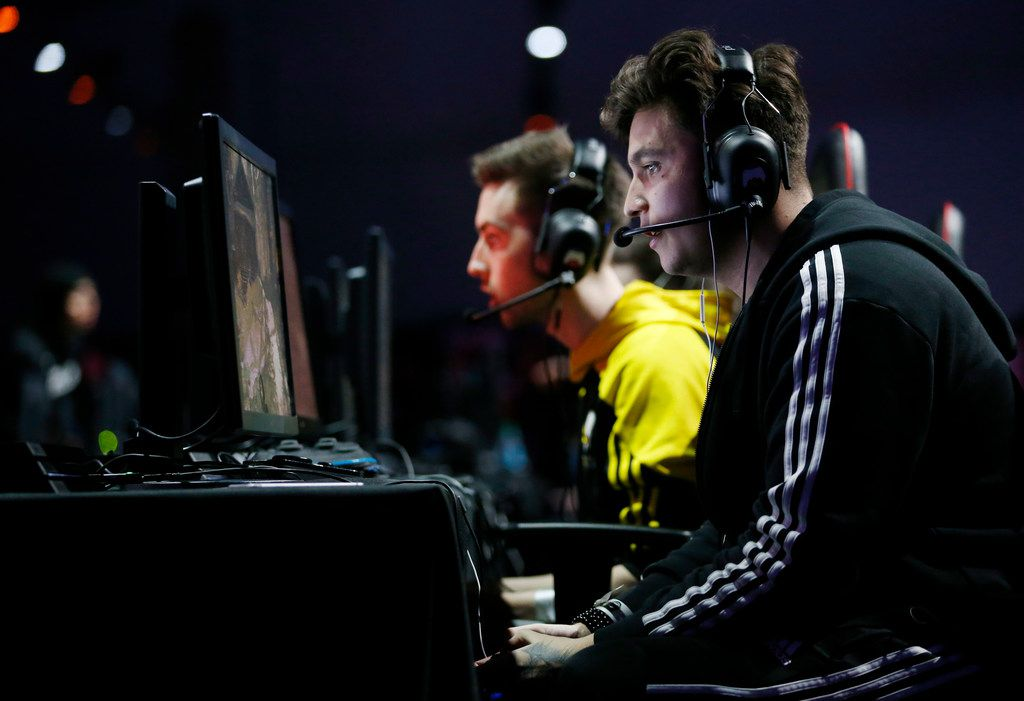 Wailers Locart, right, whose gamer name is Wailers, of team Vitality from France plays with his team against team Ground Zero in a game of Call of Duty at the Call of Duty World League tournament.