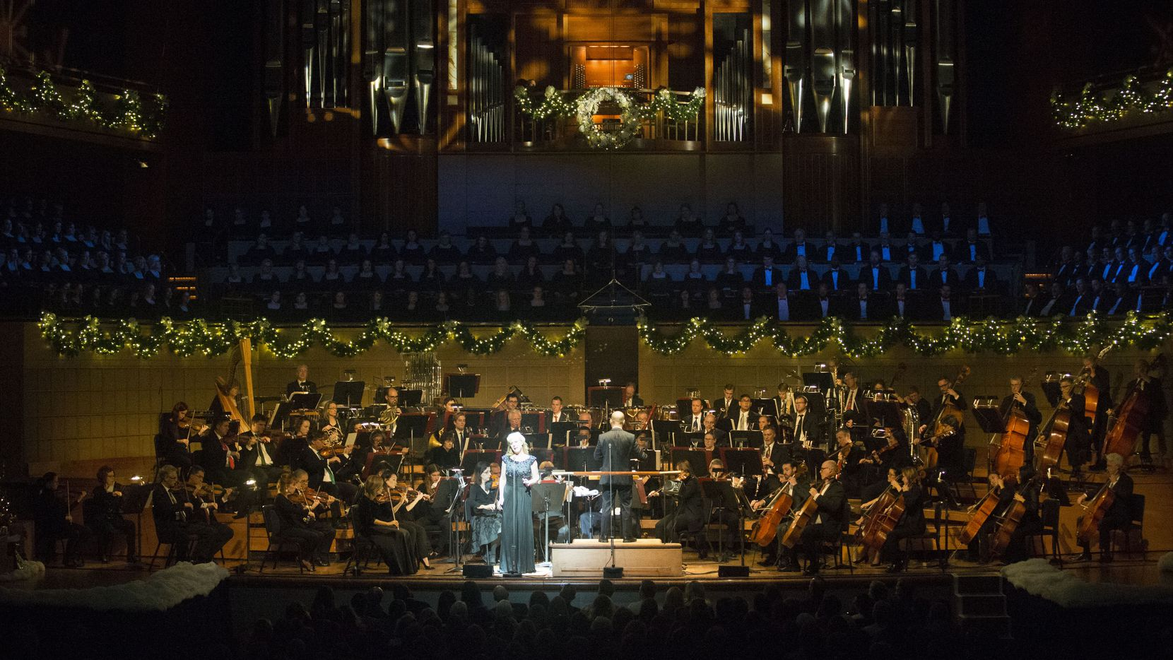 Soprano singer Katy Shackleton Williams, led by conductor Lawrence Loh, sings as the Dallas Symphony Orchestra performs its Christmas Pops concert at Meyerson Symphony Center in Dallas on Sunday, Dec. 9, 2018. Christmas Pops is an annual holiday themed concert.