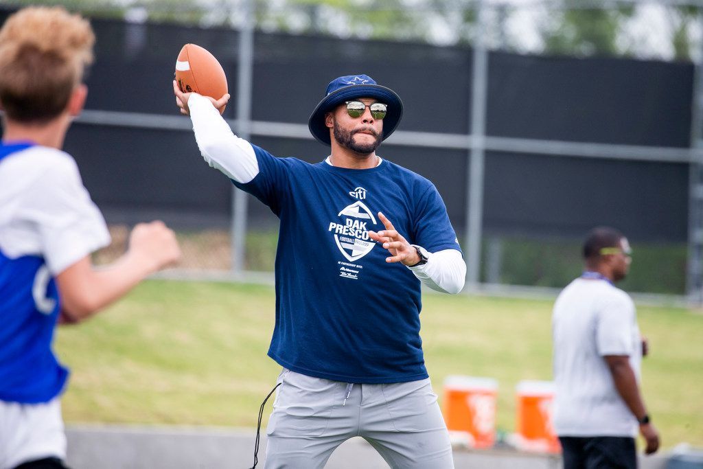 Dallas Cowboys quarterback Dak Prescott makes a pass during Dak Prescott Football ProCamp at Northwest High School in Justin, Texas on Sunday, June 23, 2019. (Shaban Athuman/Staff Photographer)