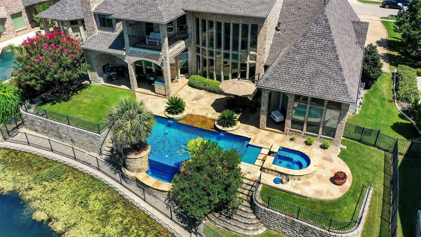 The estate at 9 Waters Edge Court in Heath's Buffalo Creek community has a negative-edge pool/spa and overlooks the 6th tee of Buffalo Creek Golf Course.