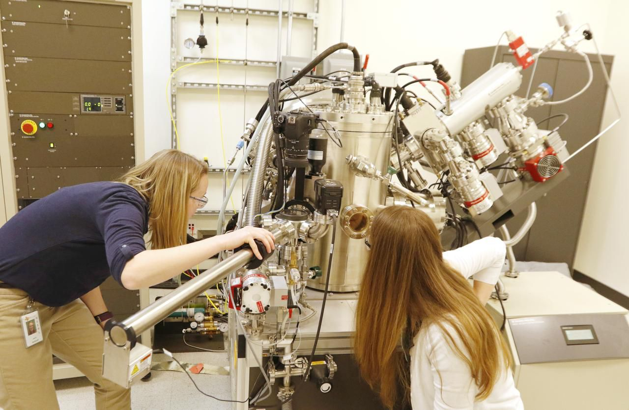 "UT-Dallas chemistry grad students  Jenny Orbeck (left) and Ashley Ellsworth used an X-ray photoelectron spectrometer to analyze a new kind of semiconductor on Friday. UTD's interim leader says the new classification is ""merely a milestone"" in bolstering research."