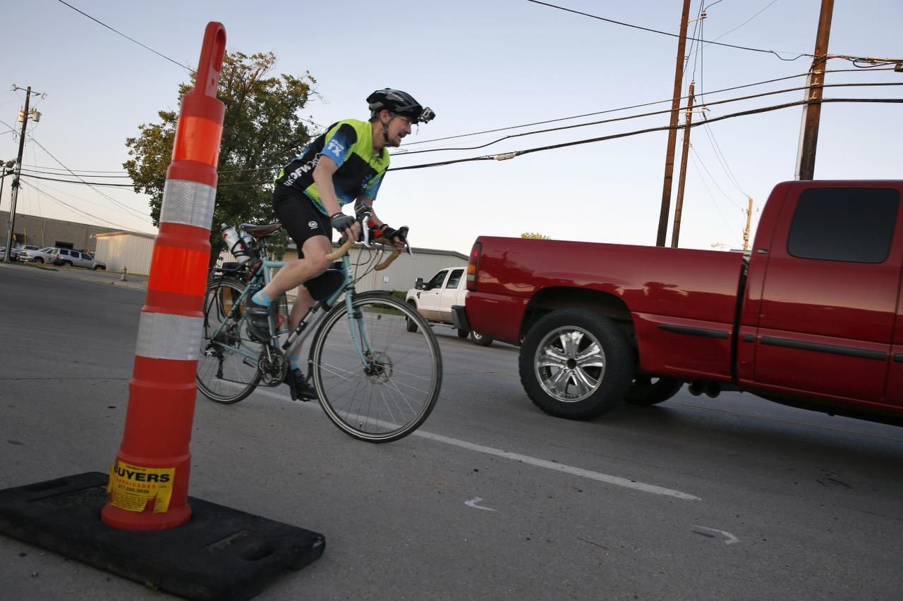 Mike McNair, who bikes 26 miles from his home in Garland to his Irving workplace, navigates through obstacles around Walnut Hill and Brockbank in Dallas. He relies on a mix of side streets, bike paths, trails and major thoroughfares during the two-hour journey.