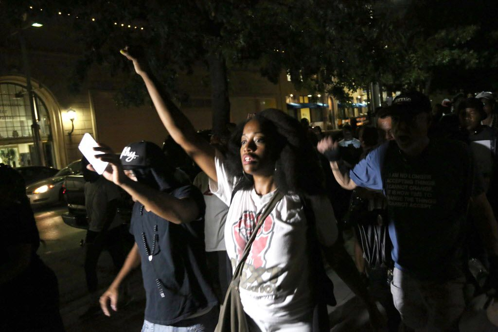 """Protesters march west on Main towards St. Paul St. during a protest held by the Next Generation Action Network in downtown Dallas Thursday September 22, 2016. The protest, which started at the Main Street Garden Park and is called """"Enough is Enough,"""" is in reaction to recent shooting by police in Tulsa and Charlotte. (Andy Jacobsohn/The Dallas Morning News)"""