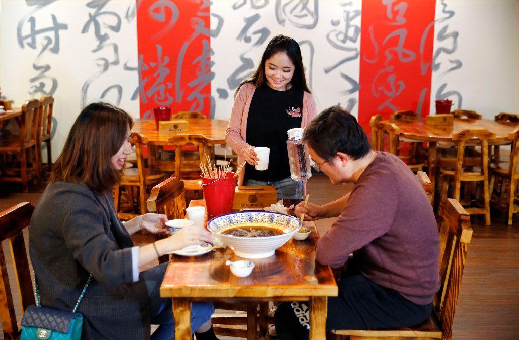Manager Eliana Ye (center) serves diners at Chuan Chuan. (Tom Fox/Staff Photographer)