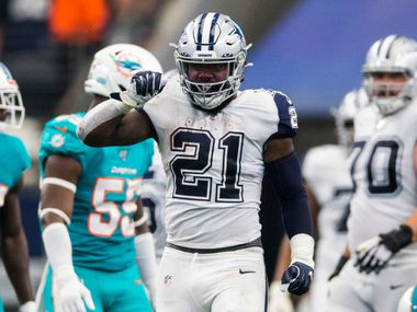 "Dallas Cowboys running back Ezekiel Elliott (21) makes a ""feed Zeke"" motion after a first down during the second quarter of an NFL game between the Miami Dolphins and the Dallas Cowboys on Sunday, September 22, 2019 at AT&T Stadium in Arlington, Texas."